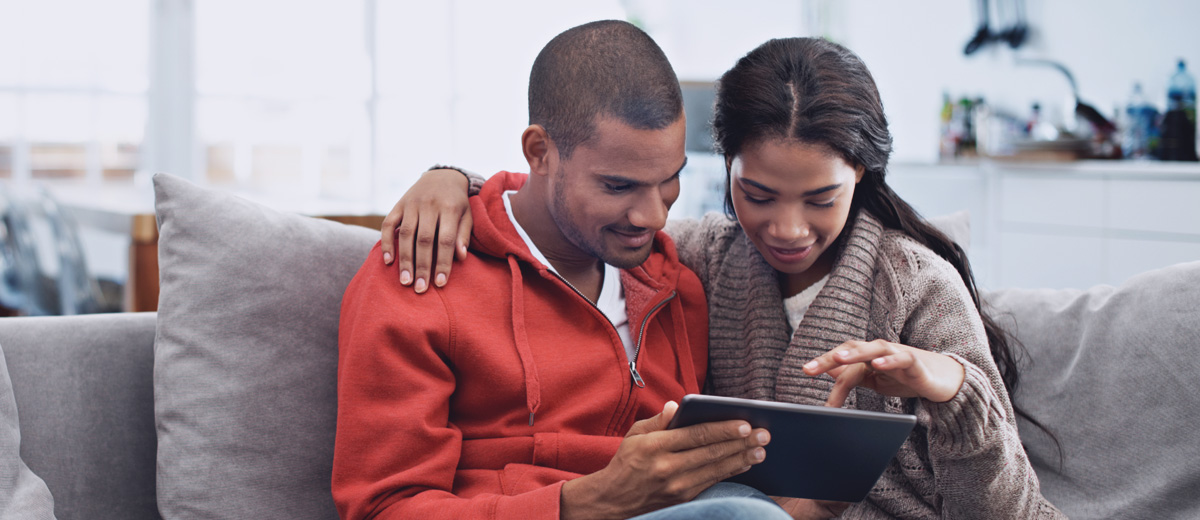 Photo of couple using a tablet