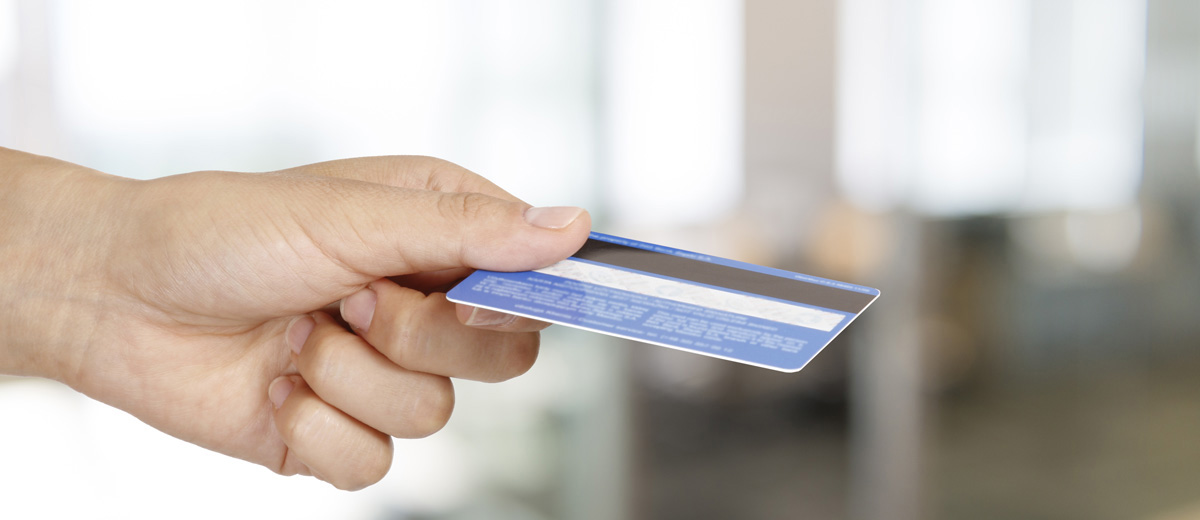 Photo of person holding credit card